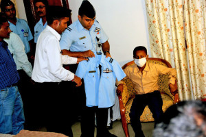 Master Chandan being helped change into the IAF Blue uniform on his arrival at Officers' Mess AF Station Ambala
